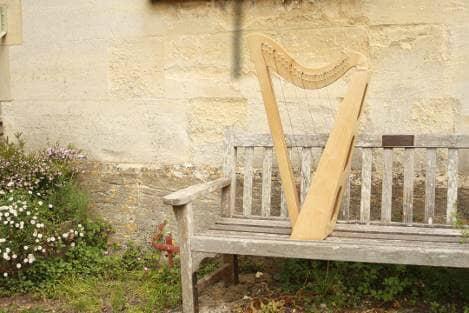 harp on garden bench
